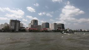 View of water transportation while travel along with Chao Phraya River in Bangkok, Thailand.  stock video