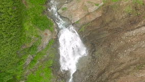 View of the waterfall from the bird`s flight. Waterfall Aerial Photo stock video footage