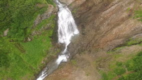 View of the waterfall from the bird`s flight. Waterfall Aerial Video stock footage