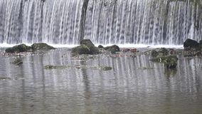 View on a Waterfall on a cold morning. Close up of a River in front of a Waterfall. Flowing Water stock footage
