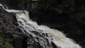 View of waterfall hitting and splash on the surface of hard rocks. Canyon Sainte-Anne stock footage