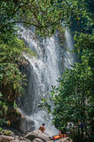 View of waterfall and people in the Itatiaia Park. Stock Photos