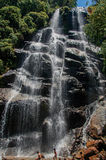 View of waterfall and people in the Itatiaia Park. Royalty Free Stock Image