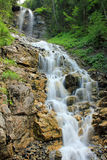 View at a waterfall in Switzerland in the mountains. Beautiful waterfall in Switzerland coming down in the mountains stock photo
