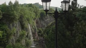 View of waterfall and tourists visiting it stock footage