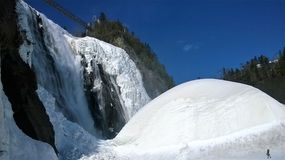 View of a waterfall under a beautiful winter day in Quebec Canada. View of a waterfall under a beautiful blue sky on a winter day in Quebec Canada Royalty Free Stock Photography