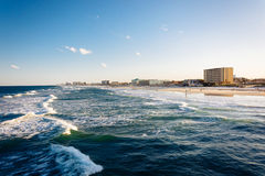 View of waves in the Atlantic Ocean and the beach from the pier Stock Image