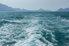 View of waves behind a boat Stock Photo