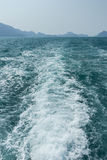 View of waves behind a boat Stock Image