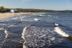 Baltic Sea and beach in Poland. View of the wavy Baltic Sea and beach in Sopot, Poland, on a sunny day in the autumn Stock Photo