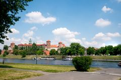 View of Wawel Castle on the Vistula River in Krakow. Historic Wawel Castle is a prominent feature along the banks of the Vistula River in Krakow Poland seen on a stock image