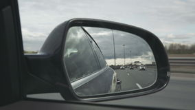 View of the way in the side mirror stock video