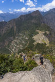 View from Waynapicchu to Machu Picchu and bus road. Was designed Peruvian Historical Sanctuary in 1981 and a World Heritage Site by UNESCO in 1983 Stock Photo