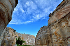 View of weathering granite canyon. Weathering and decayed granite under blue sky in Fujian, South of China, as featured geology landforms, with wonderful pattern Stock Images