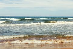 View of weaves from sea shore. View of weaves breaking over the sea shore stock images