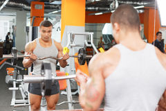 View of weightlifter in mirror with barbell Royalty Free Stock Photo