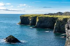 View of the west coastline of Iceland. With a steep edge of lava cliff down to the ocean below stock photos