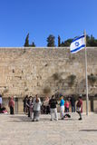 View of the west wall in Jerusalem, jewish tourists and the israeli flag Royalty Free Stock Photography
