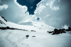 View of the western Elbrus in thick clouds near the site of a helicopter crash stock photo
