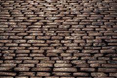 Wet cobblestone pavement Royalty Free Stock Image