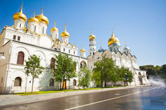 View from wet road of Patriarch's Palace. And the Church of the Twelve Apostles and Ivan the Great Bell Tower in the Moscow Kremlin, Russia in the Moscow Stock Photos