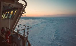 View from the wheelhouse of the Russian icebreaker on the Arctic sunset. Travel across the Kara sea. stock photography