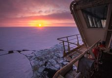 View from the wheelhouse of the Russian icebreaker on the Arctic sunset. Travel across the Kara sea. royalty free stock photography