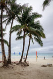 View of the White beach with palm trees in Boracay, Philippines.  Royalty Free Stock Images