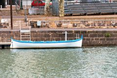View of the white boat on the river Herault, Agde, France. Copy space for text. View of the white boat on the river Herault, Agde, France. Copy space for text royalty free stock images