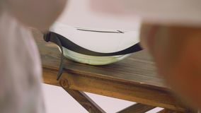 View of white fanny pack on wooden table during photosession stock footage