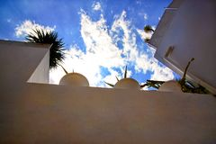 View on white houses roof balcony and blue sky with clouds in medina of hammamet Tunisia on Mediterranean coast. Royalty Free Stock Photo