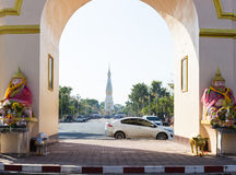 The view of white pagoda of Pratart Phanom temple from the arch Royalty Free Stock Photography