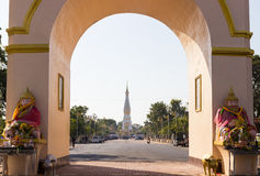 The view of white pagoda of Pratart Phanom temple from the arch Stock Images