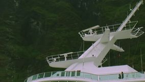 View of white radars on big cruise liner sail on river at mountains covered by green woods. stock video
