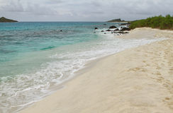 View of white sand beach of Gardner bay Stock Images