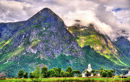 View of white wooden Oppstryn Church and mountains in Norway Royalty Free Stock Photo