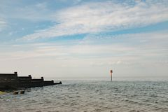 View of Whitstable bay from Whitstable beach. Including the Groynes, Large wooden barriers that split the beach Royalty Free Stock Photography