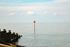 View of Whitstable bay from Whitstable beach. Including the Groynes, Large wooden barriers that split the beach Royalty Free Stock Image