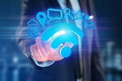 Wifi symbol connection surrounded by multimedia and internet app. View of a wifi symbol connection surrounded by multimedia and internet application logo - 3d Royalty Free Stock Images