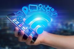 Wifi symbol connection surrounded by multimedia and internet app. View of a wifi symbol connection surrounded by multimedia and internet application logo - 3d Stock Images