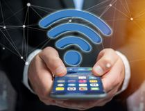 Wifi symbol displayed on a futuristic interface - Connection and Stock Photos