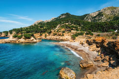 View of the wild beach with azure water, Mallorca, Spain Royalty Free Stock Images