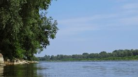 View at a Wild Part of Vistula River in Warsaw with a Man Kayaking in Background Royalty Free Stock Photo