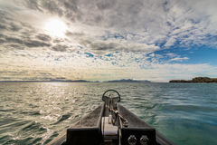 View from the wildlife safari boat at the ocean on Svalbard royalty free stock photography