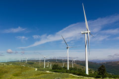 View of a wind farm with a blue sky and clouds. Stock Images