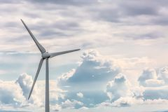 View of a wind turbine on top of mountains, cloudy sky as background. In Portugal environment electricity mill technology environmental nature windmill stock photos
