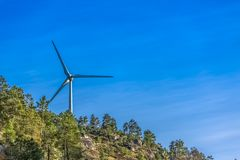 View of a wind turbine on top of mountains. Detailed view of a wind turbine on top of mountains, in Portugal environment electricity mill technology stock images