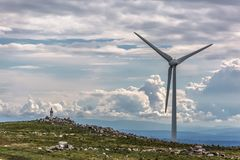View of a wind turbine on top of mountains. In Portugal environment electricity mill technology environmental nature windmill industry sky energy power stock photography