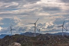 View of a wind turbine on top of mountains. View of a wind turbines on top of mountains, in Portugal environment electricity mill technology environmental nature stock images