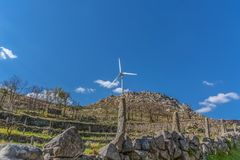 View of a wind turbine on top of mountains. In Portugal environment electricity mill technology environmental nature windmill industry sky energy power stock image